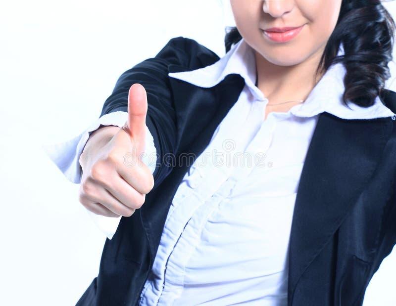 Mujer de negocios sonriente que muestra el pulgar para arriba Aislado en blanco foto de archivo
