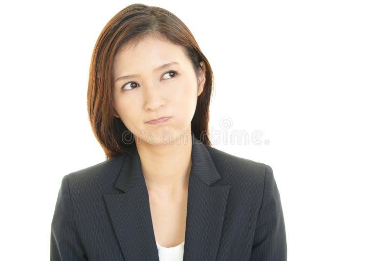 Mujer de negocios tensionada imagen de archivo libre de regalías