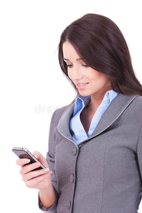 Mujer de negocios texting de su teléfono celular fotografía de archivo