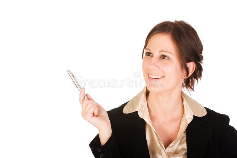 Mujer de negocios triguena que tiene una idea imagen de archivo