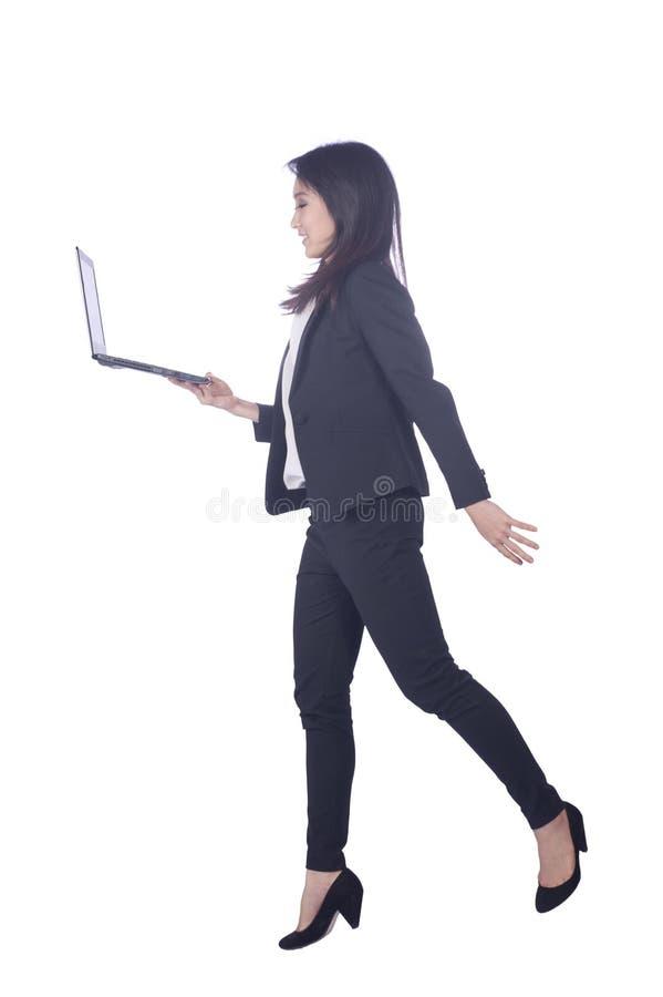 Mujer de negocios y ordenador portátil fotografía de archivo libre de regalías