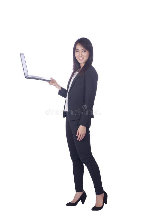 Mujer de negocios y ordenador portátil imágenes de archivo libres de regalías