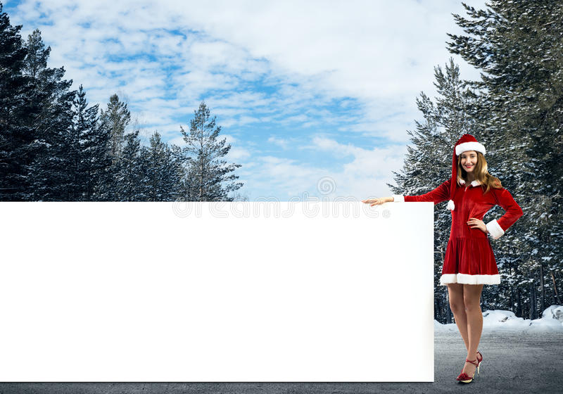 Mujer de Papá Noel con la bandera foto de archivo libre de regalías