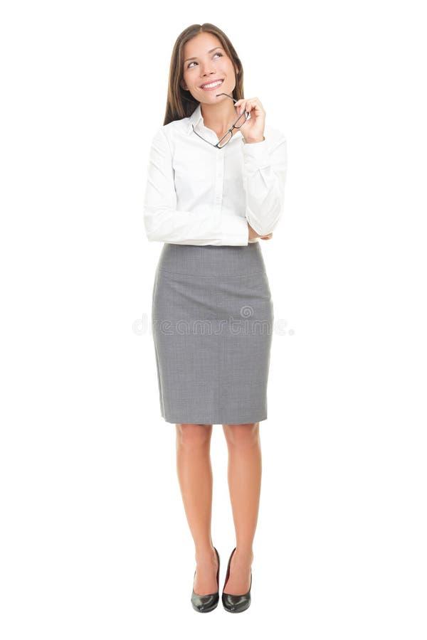 Mujer de pensamiento en el fondo blanco foto de archivo libre de regalías