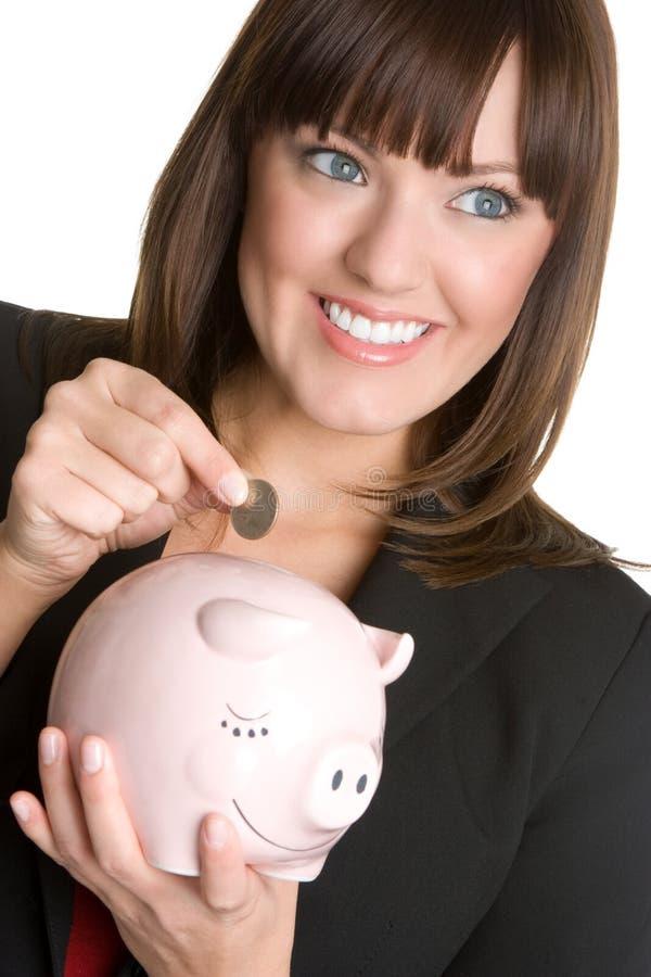 Mujer de Piggybank imagenes de archivo