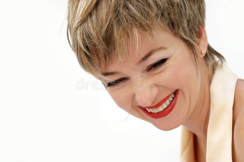 Mujer de risa foto de archivo libre de regalías
