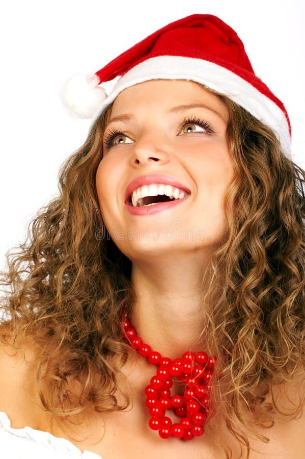 Mujer de risa en el casquillo de Santa fotos de archivo