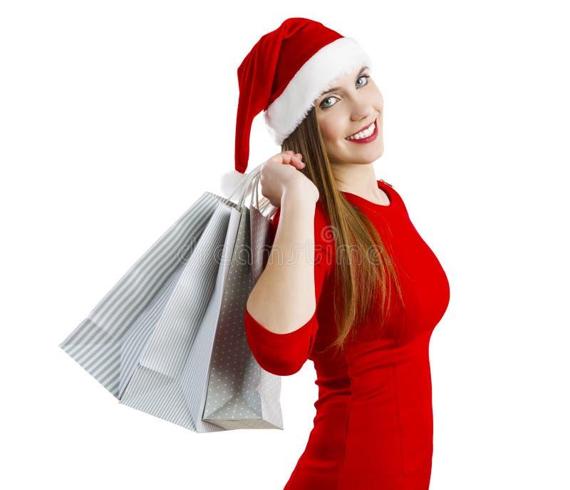 Mujer de Santa con los bolsos de compras fotos de archivo