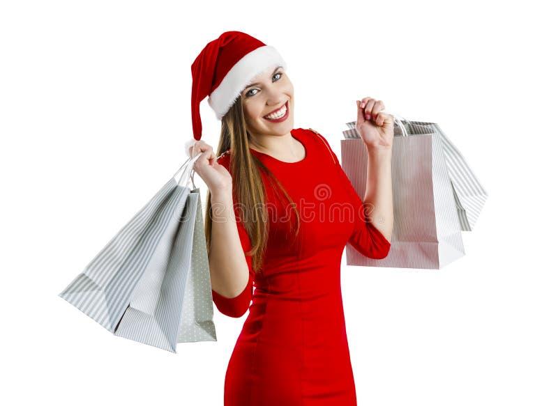Mujer de Santa con los bolsos de compras fotografía de archivo libre de regalías