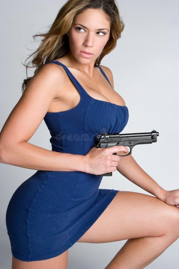 Mujer del arma foto de archivo libre de regalías