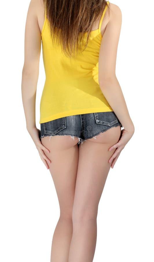 Mujer del asno pantalones cortos de un dril de algodón del cortocircuito que llevan imagen de archivo