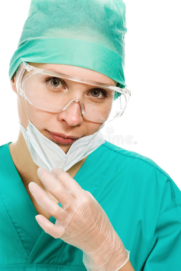 Mujer del cirujano en vidrios y máscara protectores fotos de archivo libres de regalías