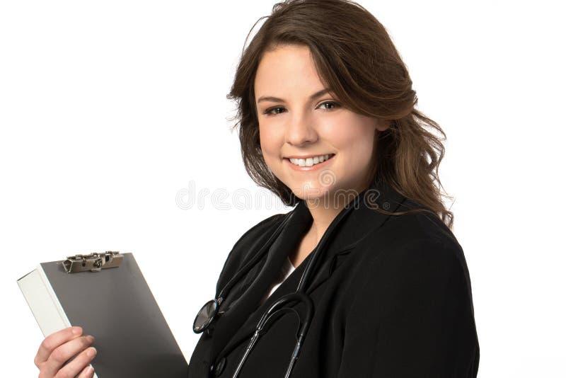 Mujer del médico con el estetoscopio Aislado sobre el fondo blanco fotografía de archivo
