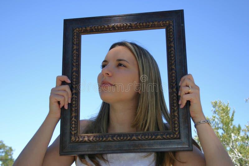 Mujer del marco imagen de archivo
