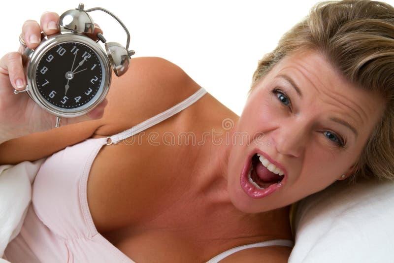 Mujer del reloj de alarma fotos de archivo libres de regalías
