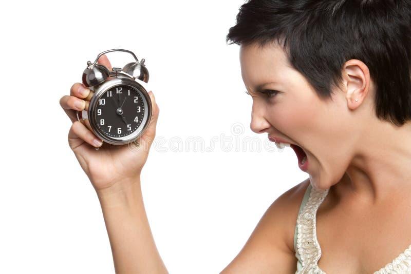 Mujer del reloj de alarma fotografía de archivo libre de regalías