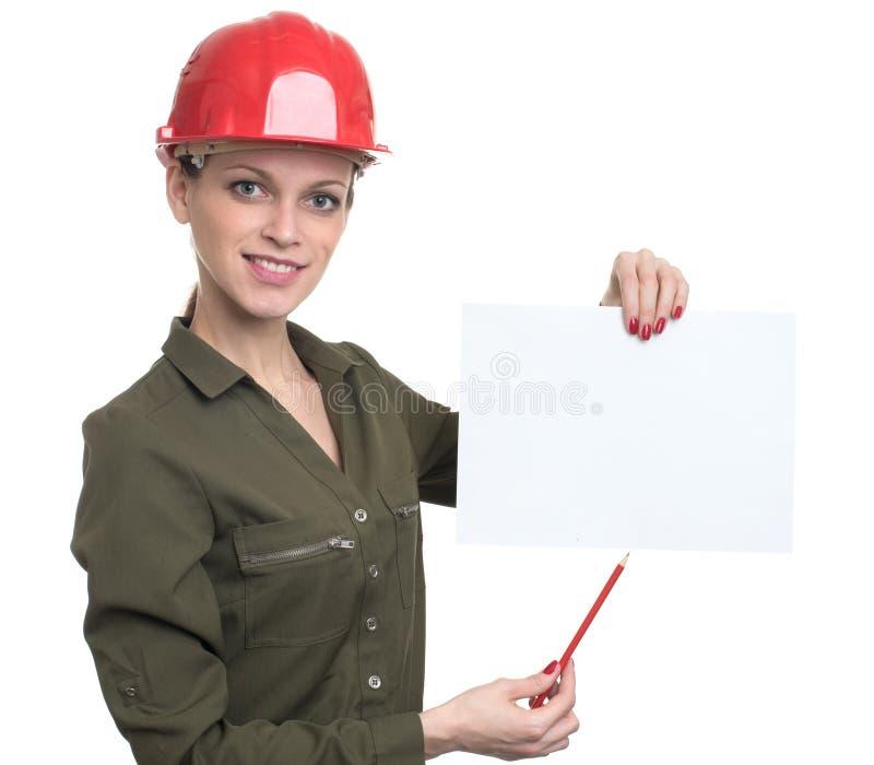 Mujer del trabajador joven que sostiene un cartel en blanco foto de archivo