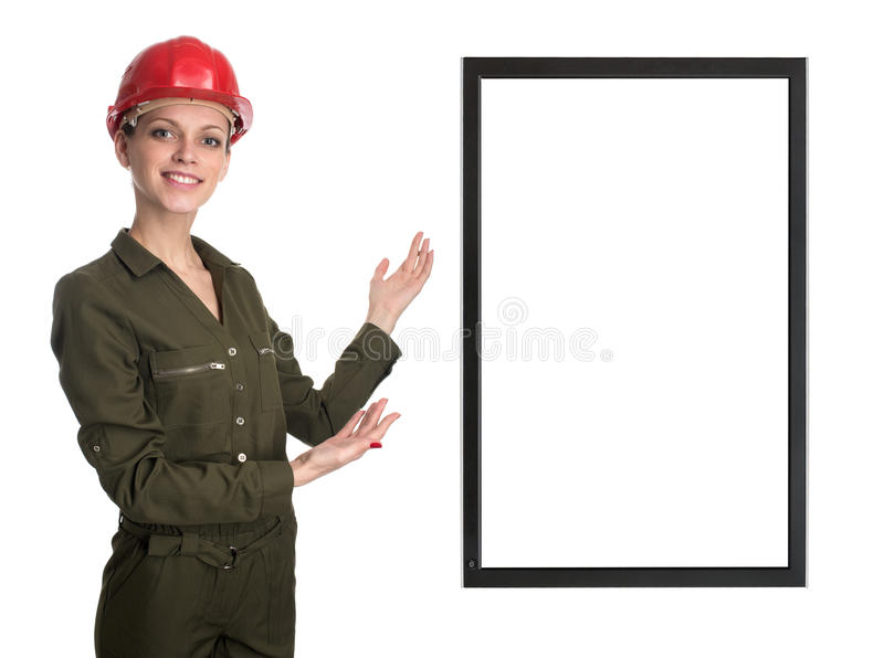 Mujer del trabajador que muestra la pantalla con el espacio de la copia imágenes de archivo libres de regalías