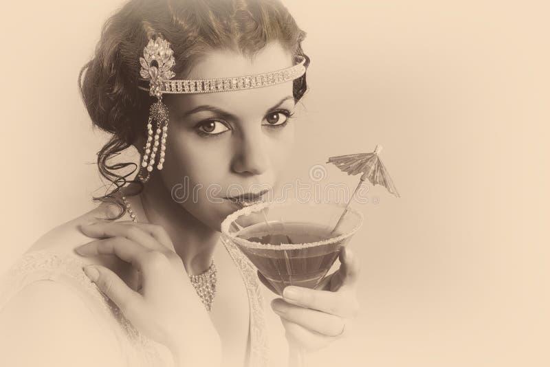 mujer del vintage de los años 20 en sepia fotografía de archivo libre de regalías