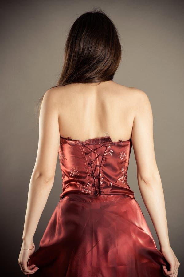 Mujer delgada en un corsé imagen de archivo
