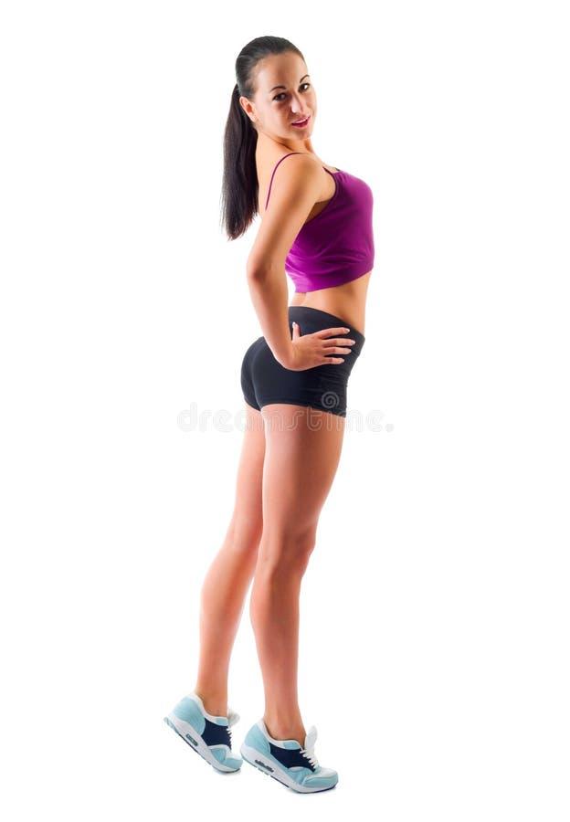 Mujer deportiva joven aislada fotos de archivo