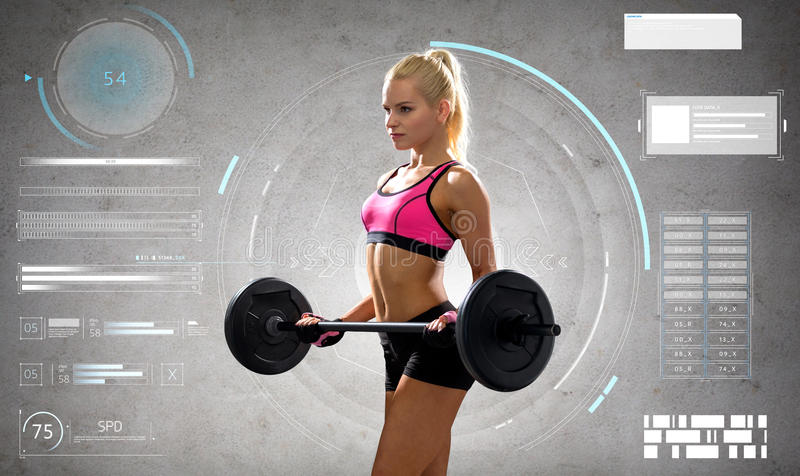 Mujer deportiva joven que ejercita con el barbell foto de archivo libre de regalías