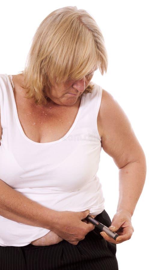 Mujer diabética imagenes de archivo
