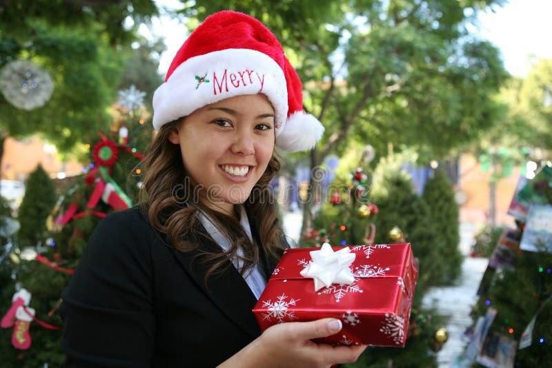 Mujer durante la Navidad fotos de archivo
