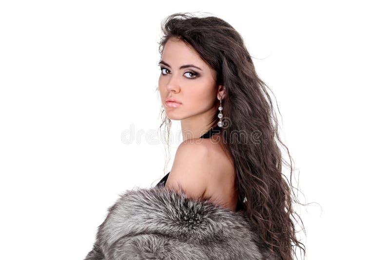Mujer elegante con el pelo rizado largo foto de archivo