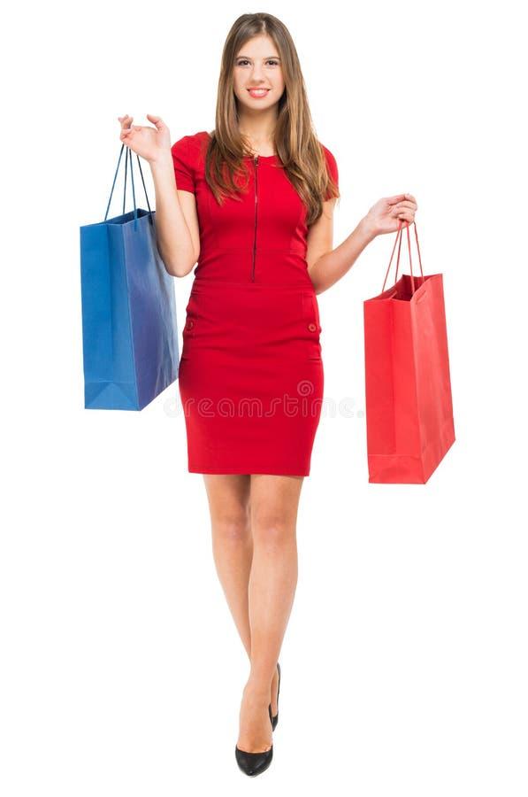 Mujer elegante con los bolsos de compras imagenes de archivo