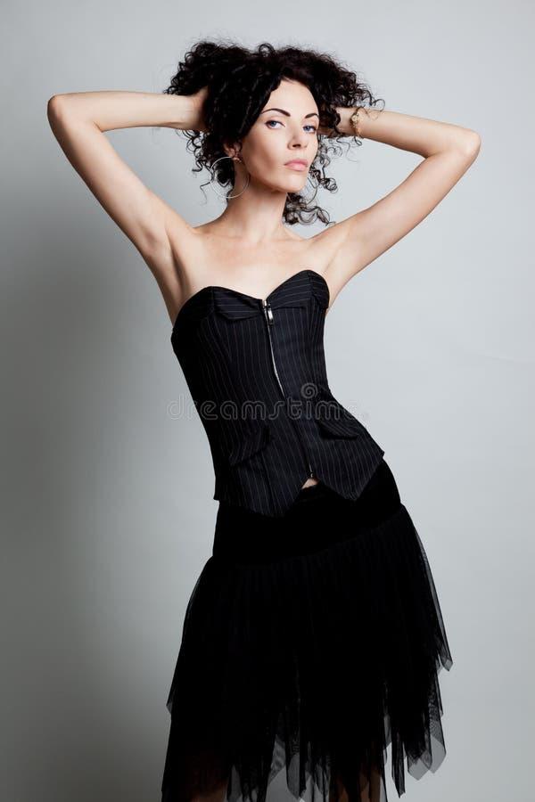 Mujer elegante en un corsé fotos de archivo