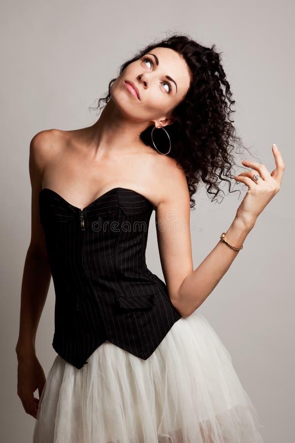 Mujer elegante en un corsé fotografía de archivo