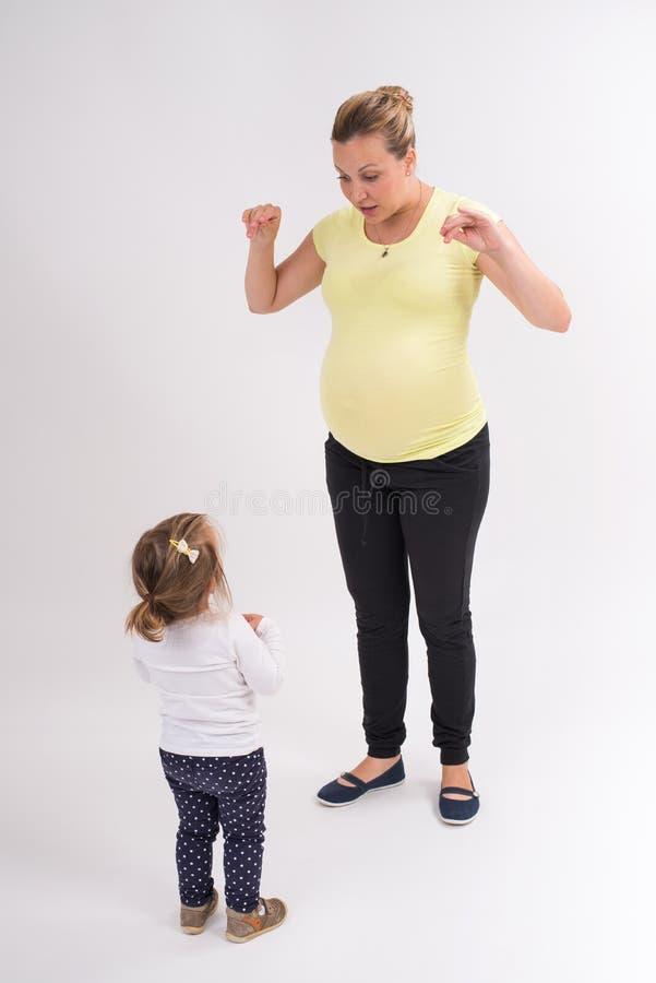 Download Mujer embarazada foto de archivo. Imagen de nuevo, blanco - 42433692