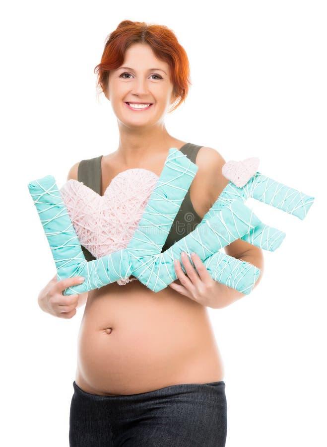 Mujer embarazada con amor de la palabra foto de archivo