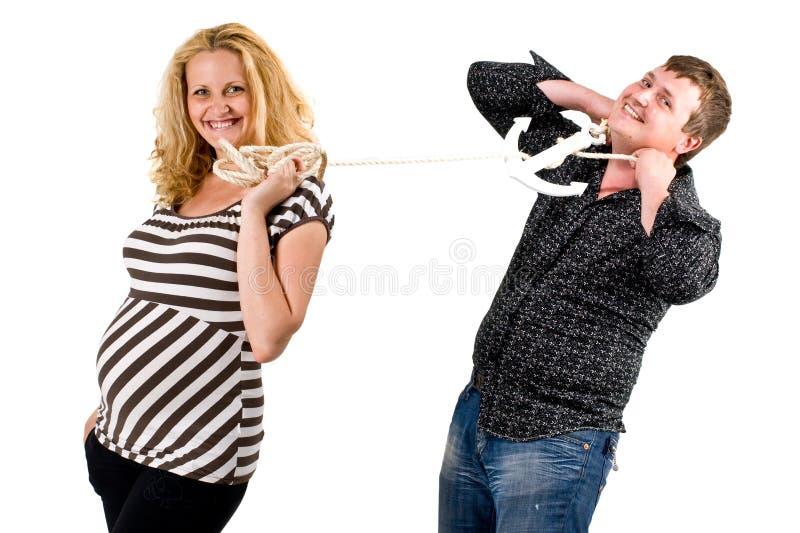 Mujer embarazada con el hombre roped fotografía de archivo