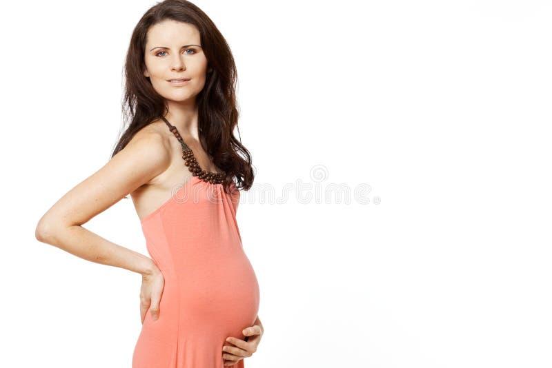 Mujer embarazada con el pelo oscuro largo. foto de archivo libre de regalías