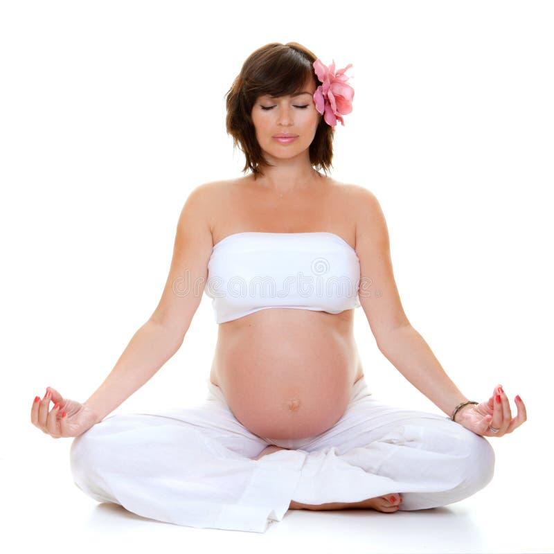 Mujer embarazada de la yoga, fotografía de archivo libre de regalías