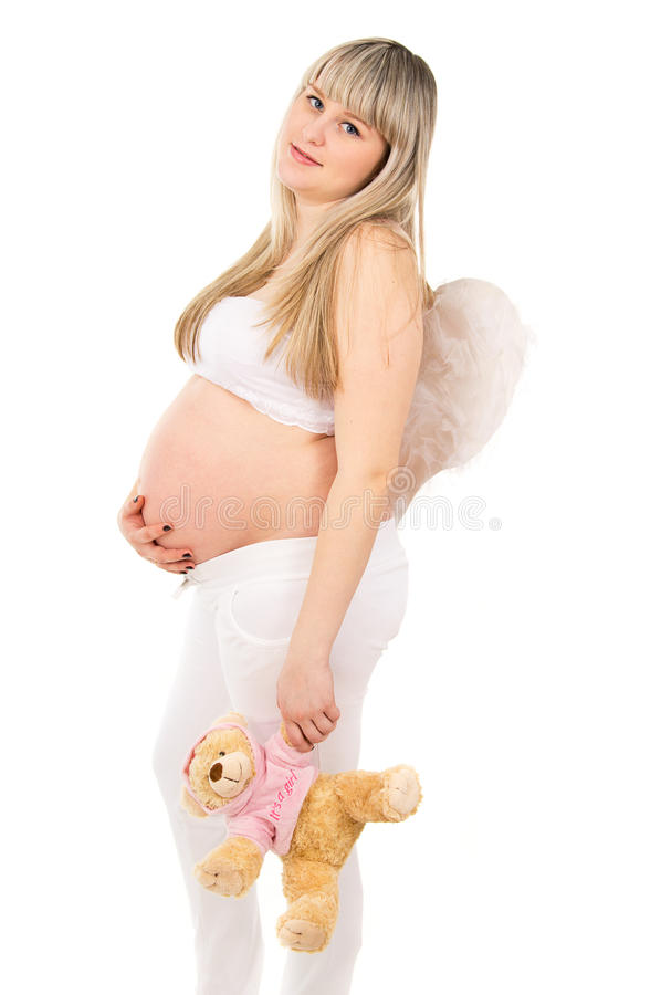 Mujer embarazada feliz en la carne, un ángel fotos de archivo