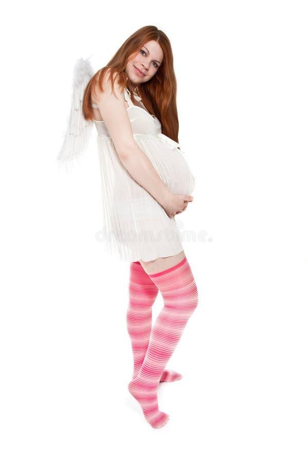Mujer embarazada hermosa con las alas fotos de archivo libres de regalías
