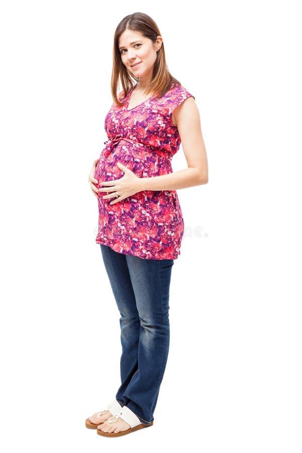 Mujer embarazada hispánica hermosa foto de archivo