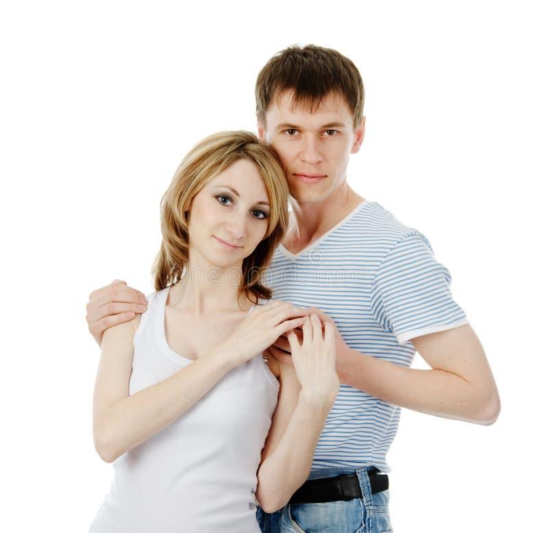 Mujer embarazada y hombre hermosos sonrientes Aislado en la parte posterior del blanco fotos de archivo libres de regalías