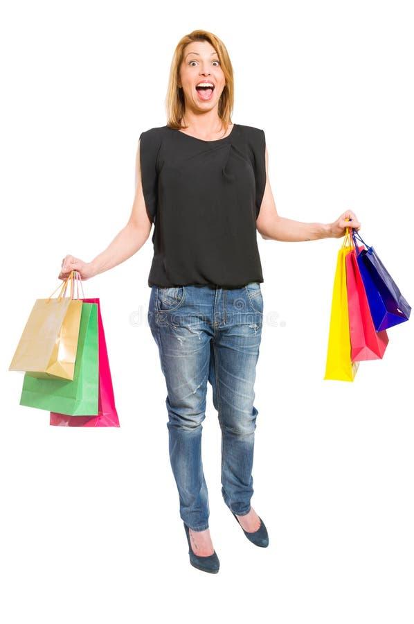 Mujer emocionada de las compras fotografía de archivo