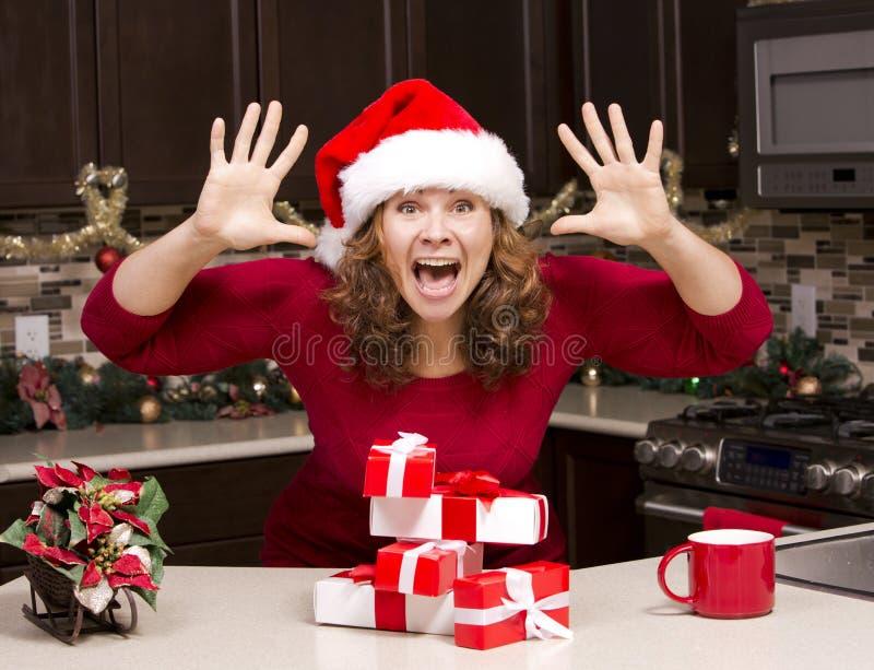 Mujer emocionada durante la Navidad imágenes de archivo libres de regalías