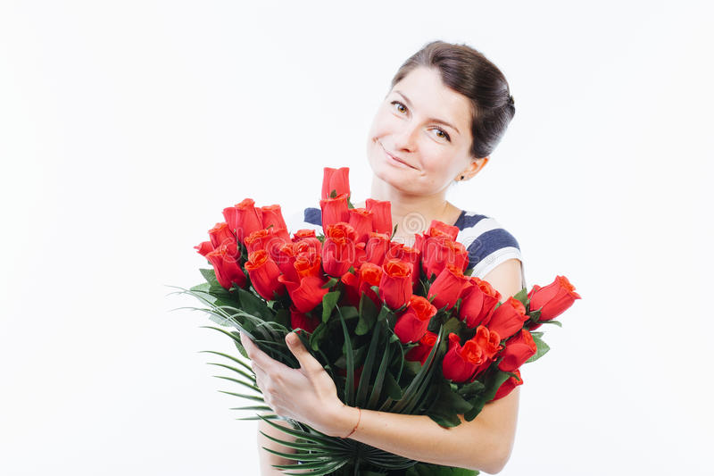 Mujer emotiva que sostiene las flores imagen de archivo libre de regalías