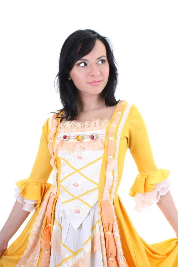 Mujer en alineada medieval amarilla sobre blanco fotos de archivo libres de regalías