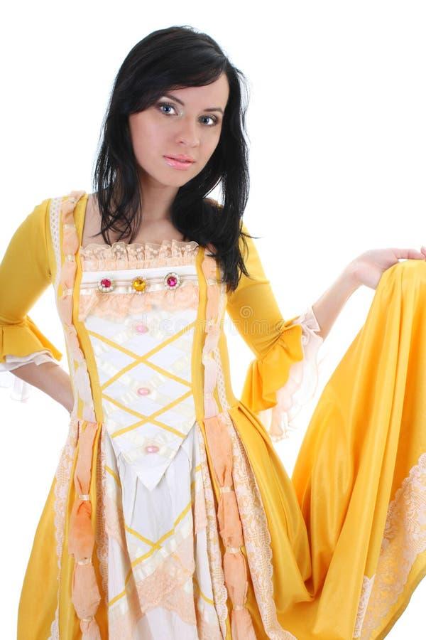 Mujer en alineada medieval amarilla sobre blanco fotografía de archivo libre de regalías