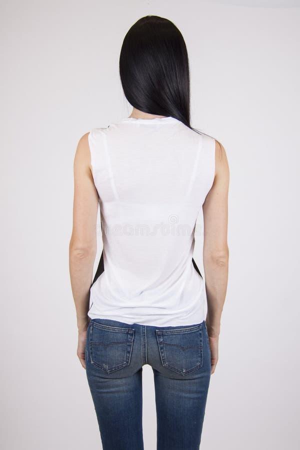 Mujer en camisa sport de la parte posterior, spce de la copia para el texto imagenes de archivo