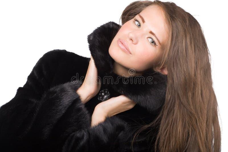 Mujer en capa de visión foto de archivo libre de regalías