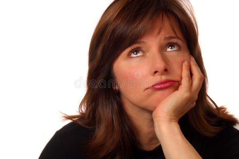 Mujer en duda imagen de archivo libre de regalías