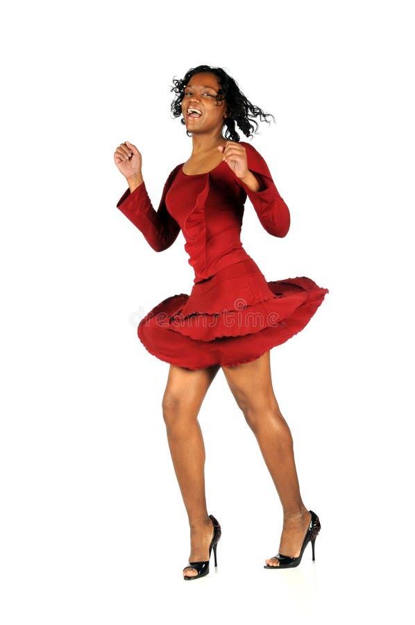 Mujer en el baile rojo de la alineada imagenes de archivo